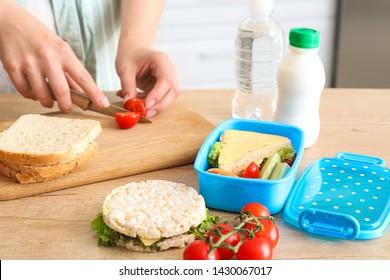 Woman preparing tasty lunch in kitchen