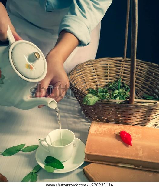 woman-preparing-tea-different-herbs-600w