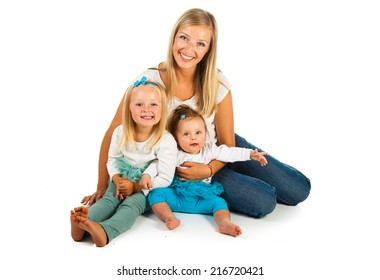 Woman with preschool and newborn daughters