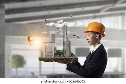 Woman presenting construction model