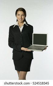 Woman presenting a laptop computer
