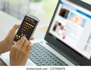 A woman presses a button to evaluate services for online shopping on a virtual touch screen on a smartphone. Customer service evaluation concept