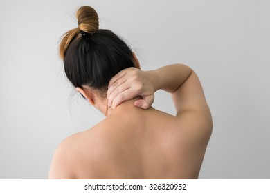 Woman pressing her hand on painful neck. Pain in the human body