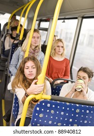 Woman pressing the stop button on the bus