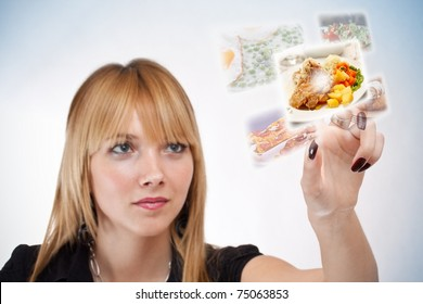 woman pressing a touchscreen button, with food selection