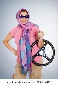 a woman, pretending to drive a car