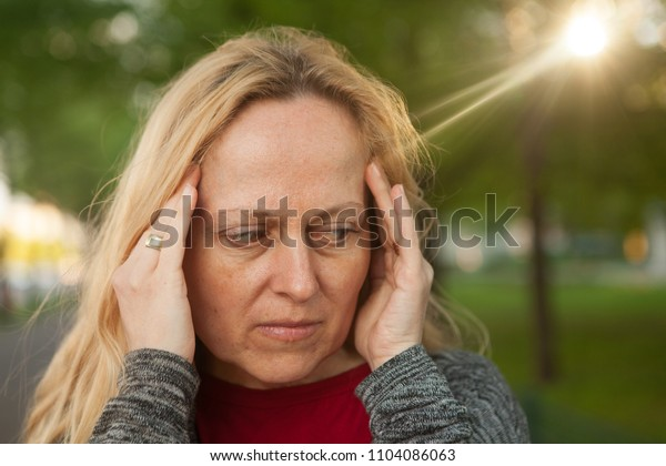 Woman with problems or headache