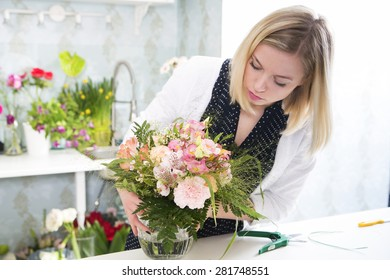 Woman in the process of boquet composition