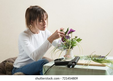 Woman in process of diy flower bouquet crafting