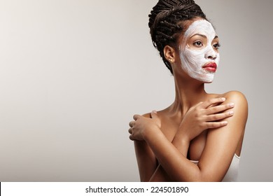 woman in process of a facial treatment