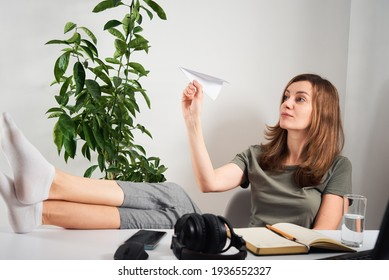 Woman procrastinate at home workplace. Remote work and home office problem