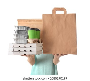 Woman with products in paper bags and containers on white background. Food delivery service