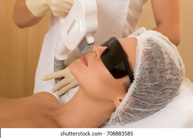 Woman in professional beauty salon during photoepilation procedure