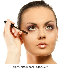 Woman with professional makeup and eyelash brush