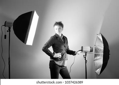 Woman professional photographer at studio