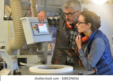 Woman in professional training, wood industrial site