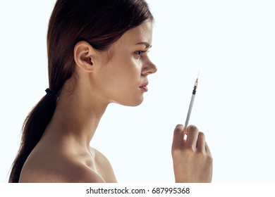 Woman in profile with a syringe