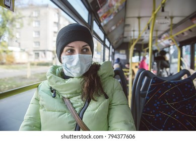 A woman is protected from viruses in public transport.