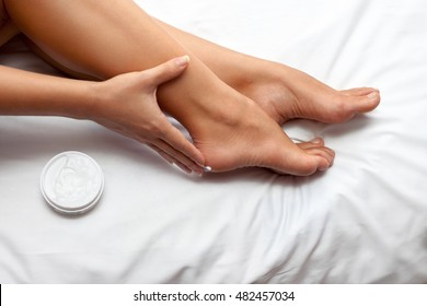 Woman protecting her feet with cream