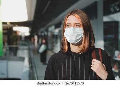 Woman in a protective face mask at a shopping mall. Coronavirus, COVID-19 spread prevention concept, responsible social behaviour of a citizen