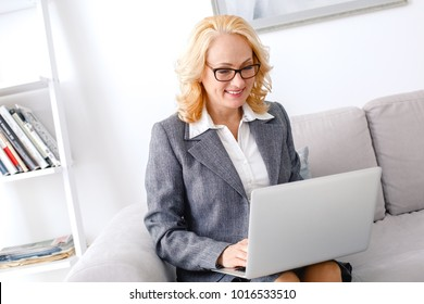 Woman psychologist portrait sitting at casual home office online help