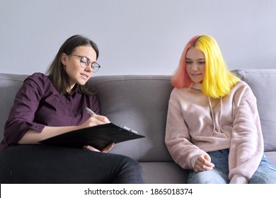 Woman psychologist working with teen girl. Visit and counseling of professional mental and social therapist. Psychology, teenager, problem, trauma, mental health of adolescents concept