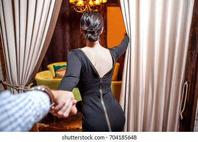 Woman pulling arm her man in cafe , First-person view