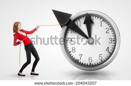 Woman pulling clock hands backwards