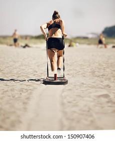 Woman Pulling Crossfit Sled