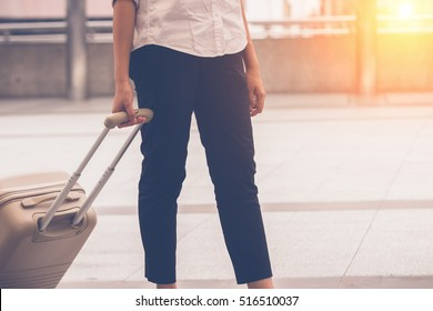 A woman are  pulling suitcase in the city
