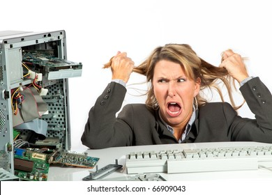 Woman pulls her hair out over her broken computer