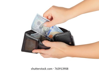 the woman pulls out or put us dollars from her purse isolated on white background