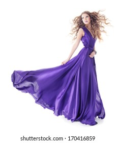 Woman in purple silk waving dress with long hairs, Beauty Fashion Girl Turning on white background