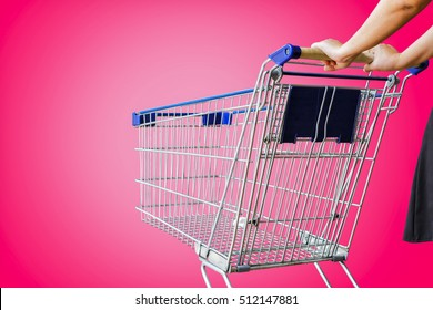 woman pushing shopping cart isolate on pink background