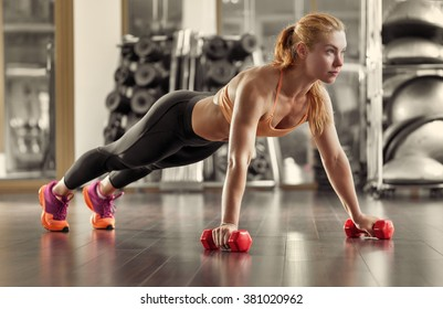 Woman push-ups on the floor