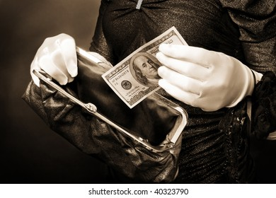 Woman in put cash in wallet wearing white gloves