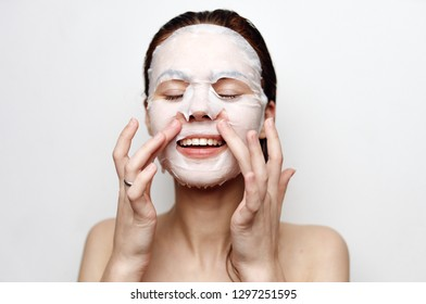 woman put a cosmetic mask on face