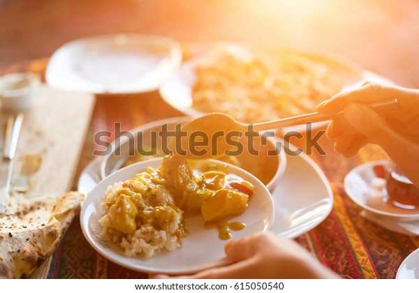 Woman puts food on a plate, sunny