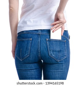 Woman puts mobile phone in jeans pocket on white background. Isolation
