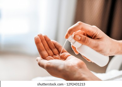 A woman puts on the hands of cosmetics from a bottle or liquid natural soap. Body care concept