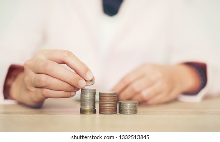 Woman putting coin in piggy bank. saving money, budget, investment, finance concept - Image