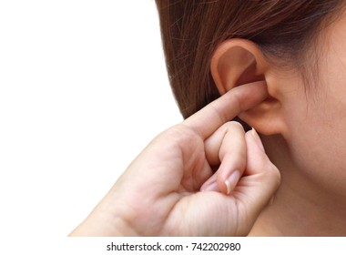 Woman putting a finger into her ear / Itchy ear isolated with copy space