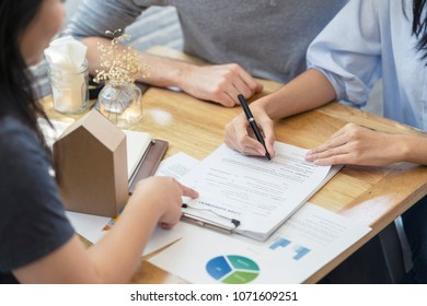 woman putting signature on document contract, real estate purchase, success business contract deals with sale represent.