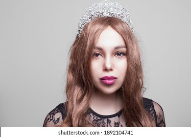 Woman queen princess in crown and dress, lights party background Luxury girl Long shiny healthy volume hair Waves Curls Hairstyle Salon Fashion model luxurious vintage interior Jewelry