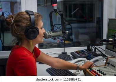 Woman radio DJ in radio studio