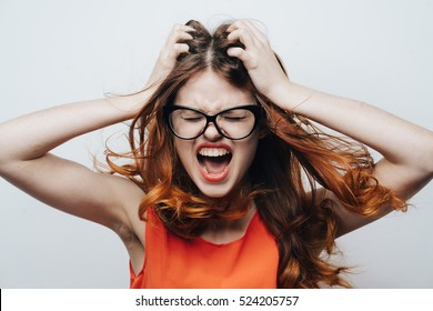 A woman in a rage. Very angry woman. Woman dissatisfied