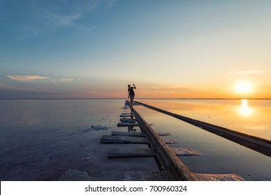 Woman at railway in the salty lake