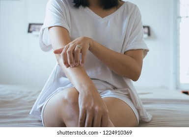 Woman with rash or papule and scratch on her arm from allergies,Health allergy skin care problem,Psoriasis vulgaris