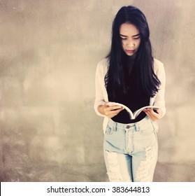 A Woman read a book:Vintage tone
