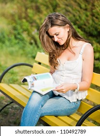 Woman read a magazine in park